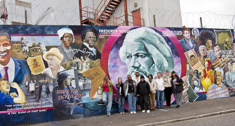 Bleeding Pines Group in front of mural in Belfast